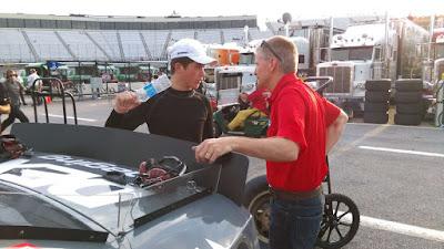 Harrison Burton talking with dad Jeff. (Speed51.com photo) #nascar