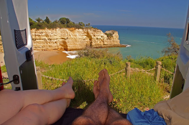 Couple campervanning in Algarve Portugal