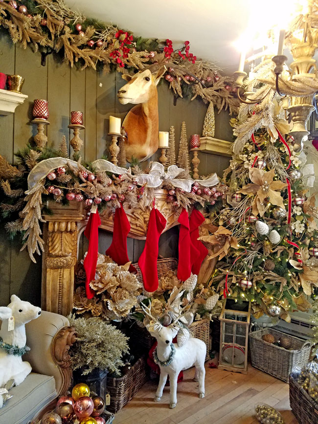 A gorgeous Christmas mantel with deer head and lots of gold