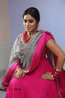Actress Poorna Pictures in Red Salwar Kameez at Jayammu Nischayammu Raa Teaser Launch  0182.JPG