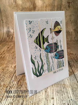 Image shows a white greetings card with a Triptych on - the Triptych is composed of fish and weeds and bubbles and is created using several stamps sets by Stampin' Up!