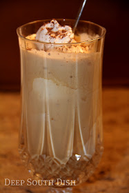 Scoops of vanilla ice cream, topped with chocolate syrup and a coffee punch, made with Godiva chocolate truffle coffee blended with more ice cream and homemade whipped cream, makes for a decadent and refreshing coffee punch float.