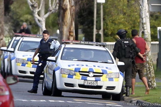 Armed Offenders Squad, AOS, police and arrested men in Barnard Ave, Maraenui, Napier. photograph