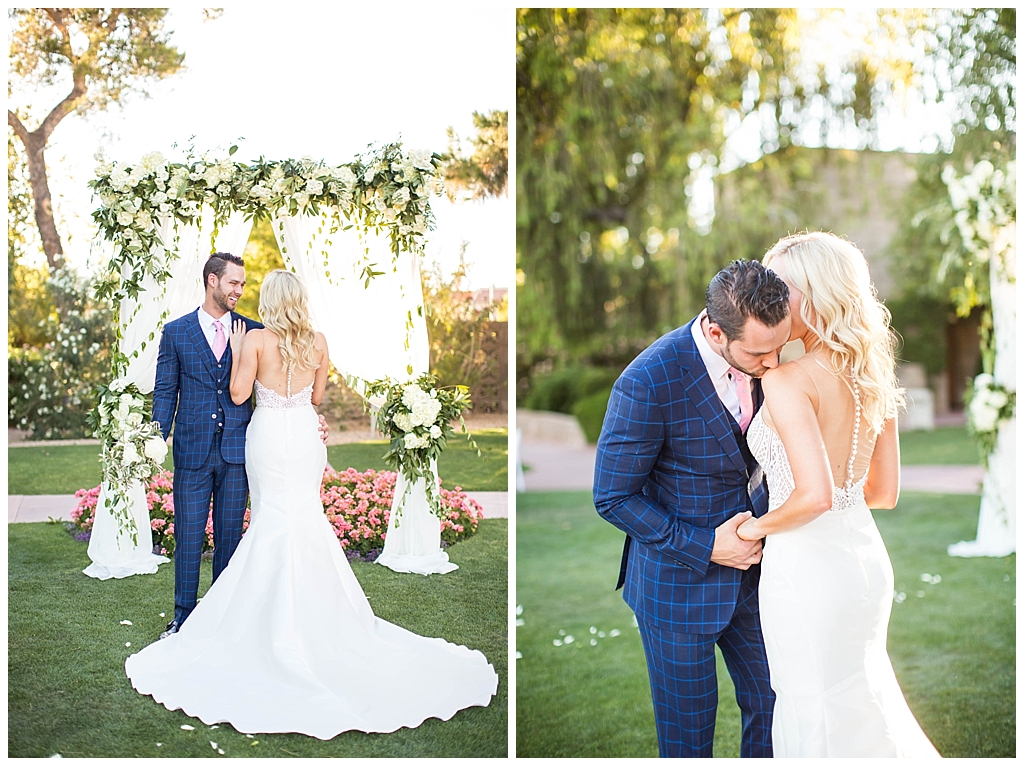bride in two piece wedding dress and groom in custom blue suit at Arizona Biltmore