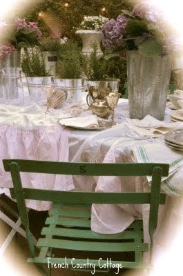 Blush bedskirt used as a tablecloth with bistro chairs