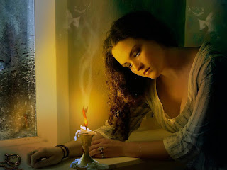 Beautiful-women-crying-near-candle-light-at-night-picture