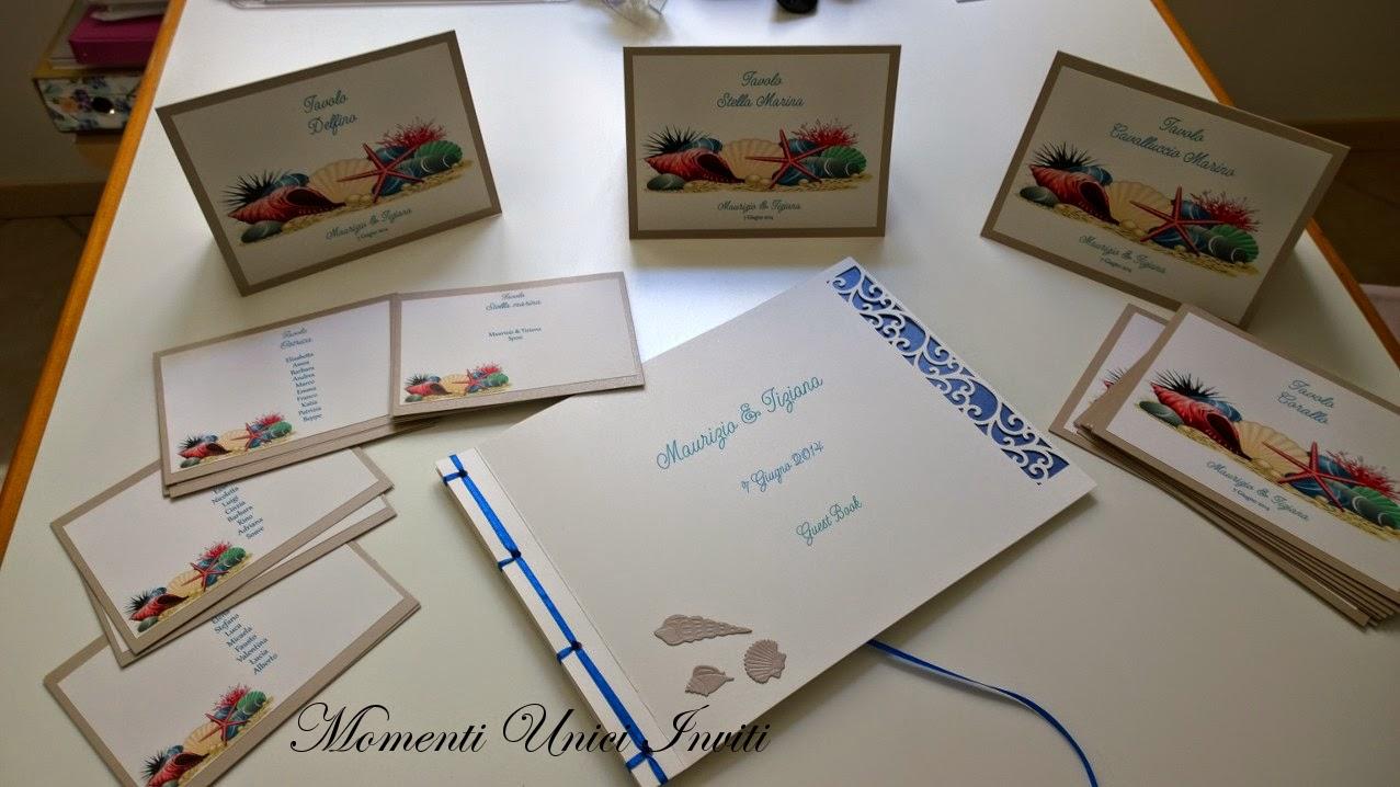 1 Guestbook e coordinato segnatavolo cards tableau tema mare per Maurizio e TizianaGuest Book Segnatavolo Tema mare