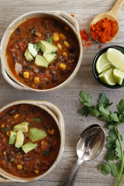 Two bowls of soup on a wooden background