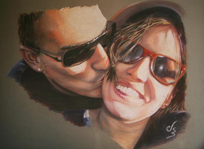 Retrato cuadro de pareja besandose con gafas