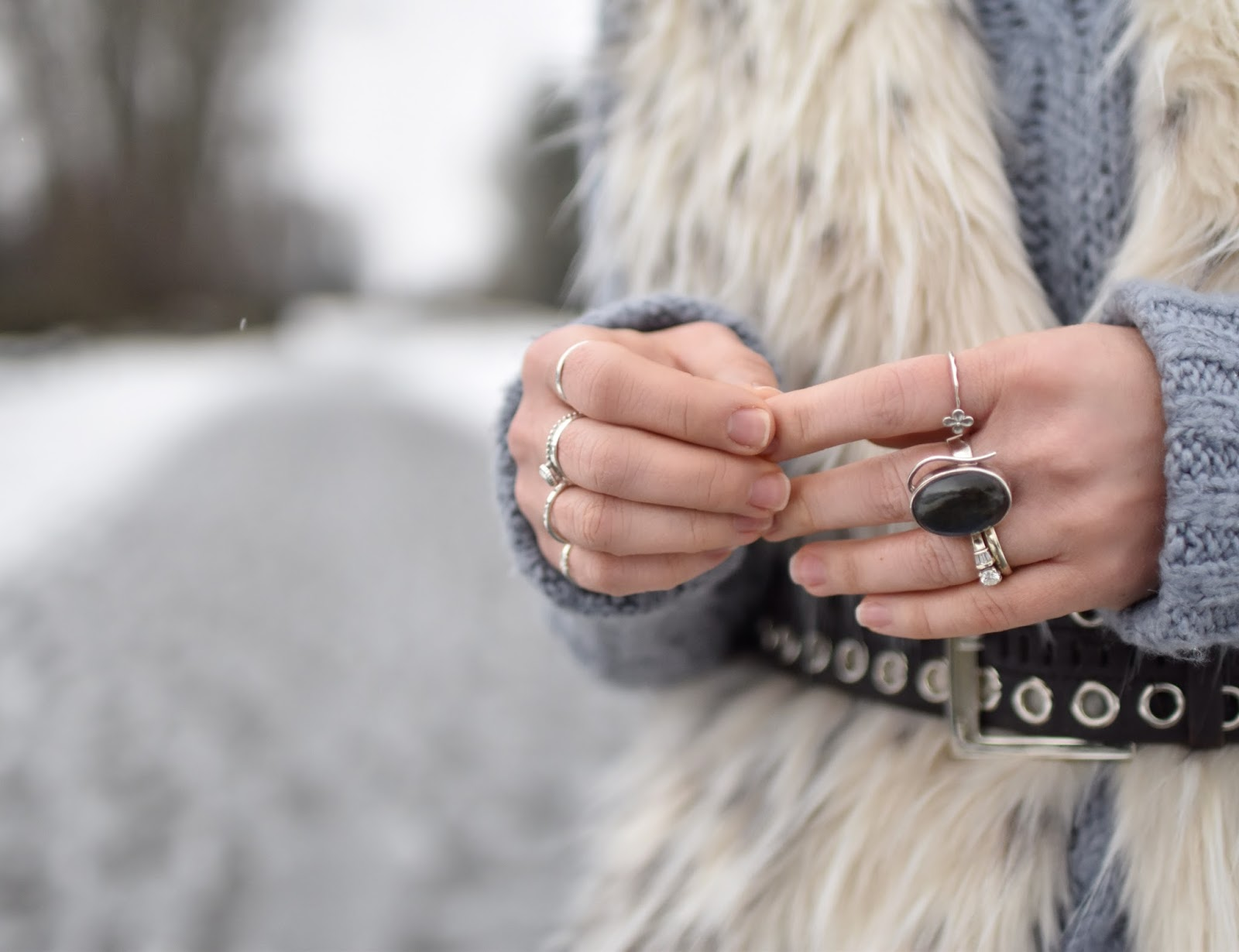 Monika Faulkner outfit inspiration - oversized sweater, belted faux-fur vest, Labradorite ring