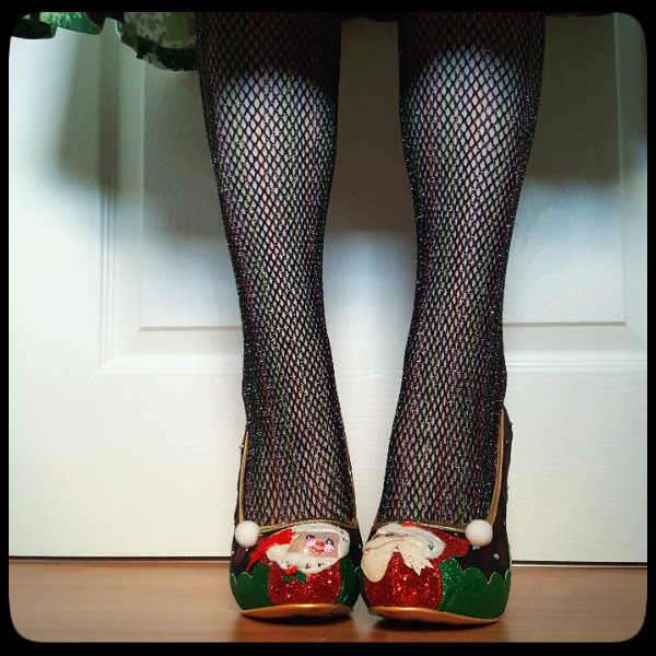 front view wearing glitter applique Santa and Mrs Claus shoes with glitter fishnet tights