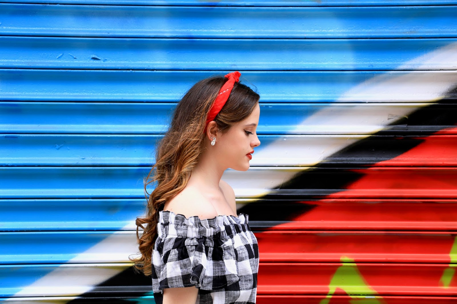 New York fashion blogger Kathleen Harper showing how to wear a red bandana as a headband