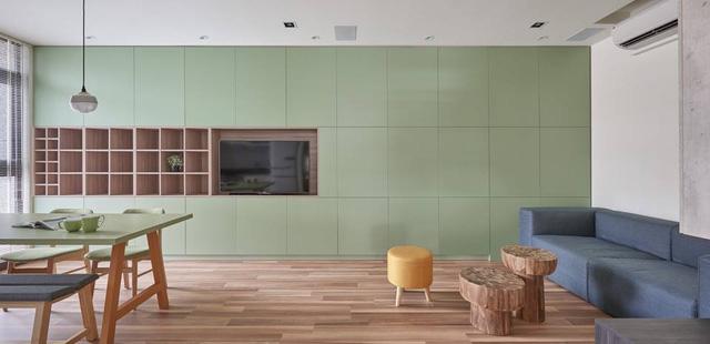 Bức tường màu xanh trang trí căn nhà