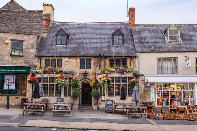 One of the many 16th century inns that line Burford High Street by Martyn Ferry Photography