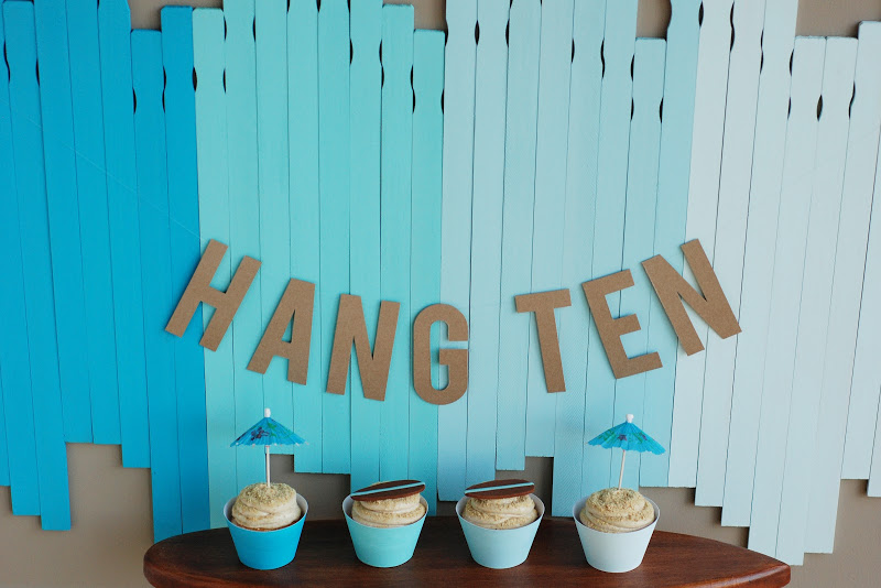 This blue ombre backdrop made of paint sticks is great for a birthday party.