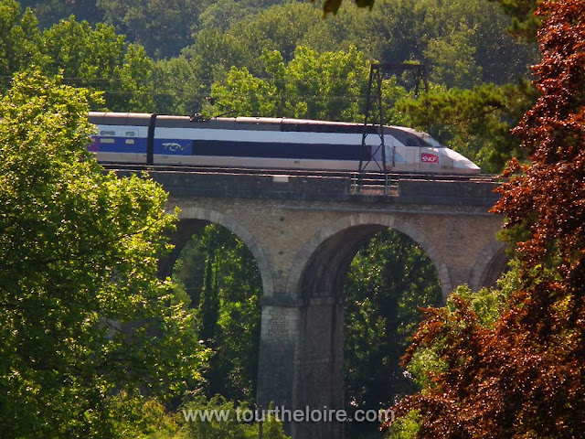 TGV (fast train) crossing the viaduct at Cande.  Indre et Loire, France. Photographed by Susan Walter. Tour the Loire Valley with a classic car and a private guide.