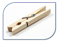 Wooden clothes peg in a customized rectangle with rounded corners.