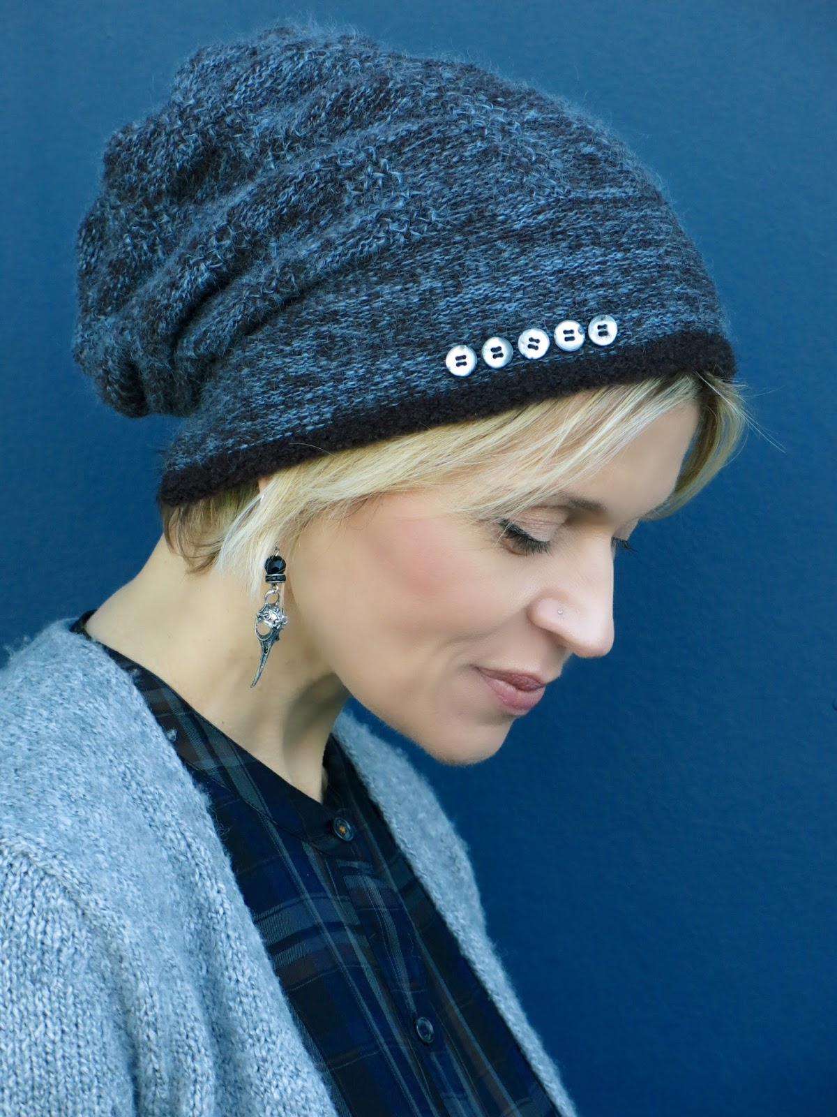handknit wool beanie and bird-skull earrings