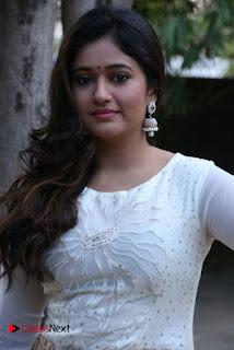 Actress Poonam Bajwa Pictures in White Dress at Muthina Kathirikai Movie Audio Launch  0001.jpg