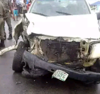 A white Hilux truck involved in an accident