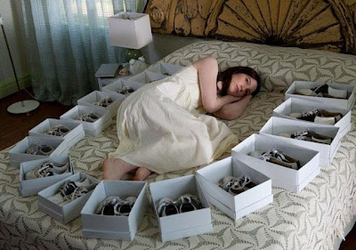 Mia Wasikowska as India Stoker in Chan-wook Park's Stoker, lying on bed, surrounded by boxes of shoes, birthday presents