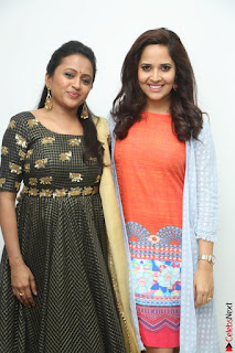 Actress Suma in Black Salwar Suit and Anusuya in orange Dress at winner movie press meet part 1 February 2017 (58).JPG