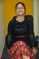 Aditi Myakal in Spicy Red Short Skirt and Transparent Black Top at at Big FM For Promotion of Movie Ami Tumi 003.JPG