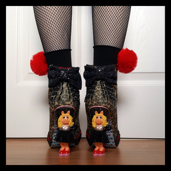 back view of Miss Piggy character heeled boots worn with fishnet tights