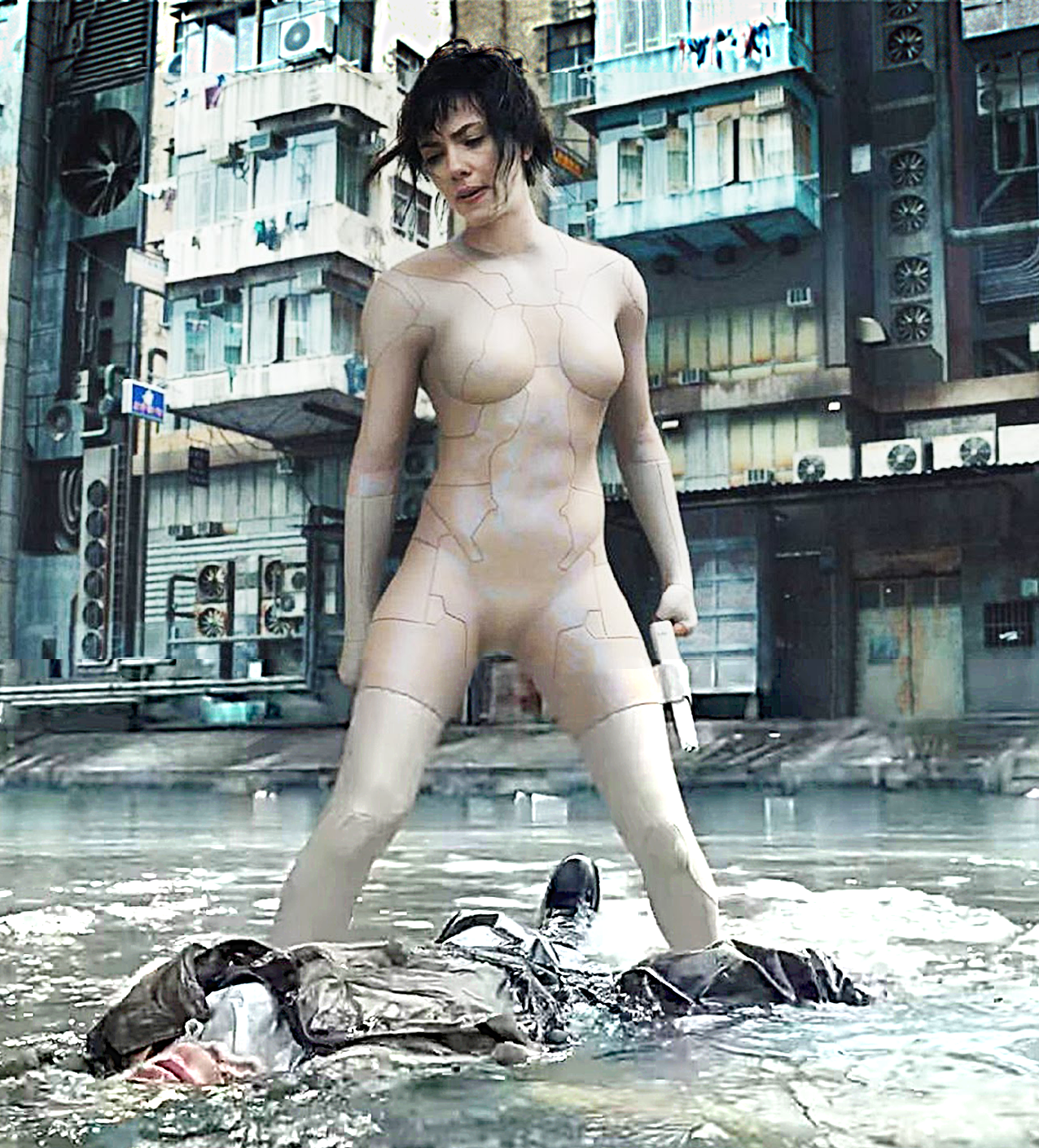 Scarlett Johansson debuts 'nude' as The Major/Motoko Kusanagi punching an unidentified man.
