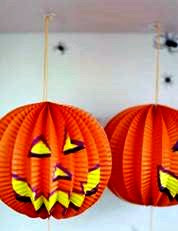 picture hanging solutions - orange paper pumpkin decorations