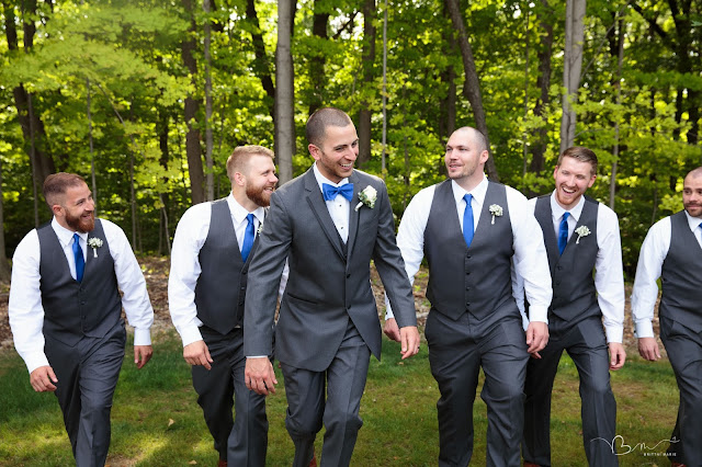 groomsmen walking at Noah's Event Venue in Auburn Hills Michigan