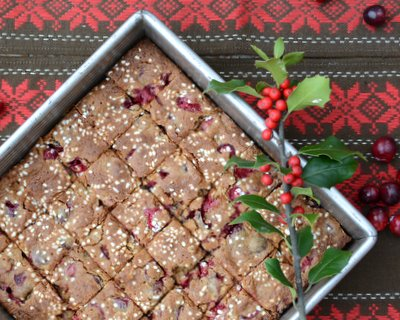 Fresh Cranberry Bars, a chewy almost-blondie molasses and spice bar with bursts of juicy fresh cranberries, topped with a scattering of sugar 'snow'. Addictive!