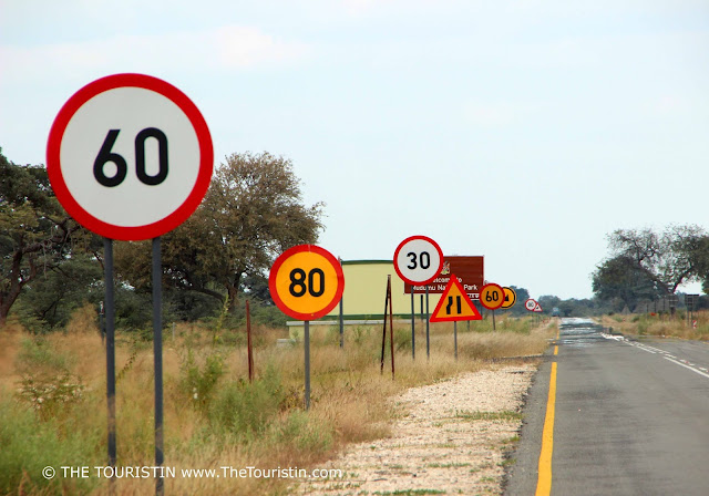 Street signs that make no sense on a road in Namibia