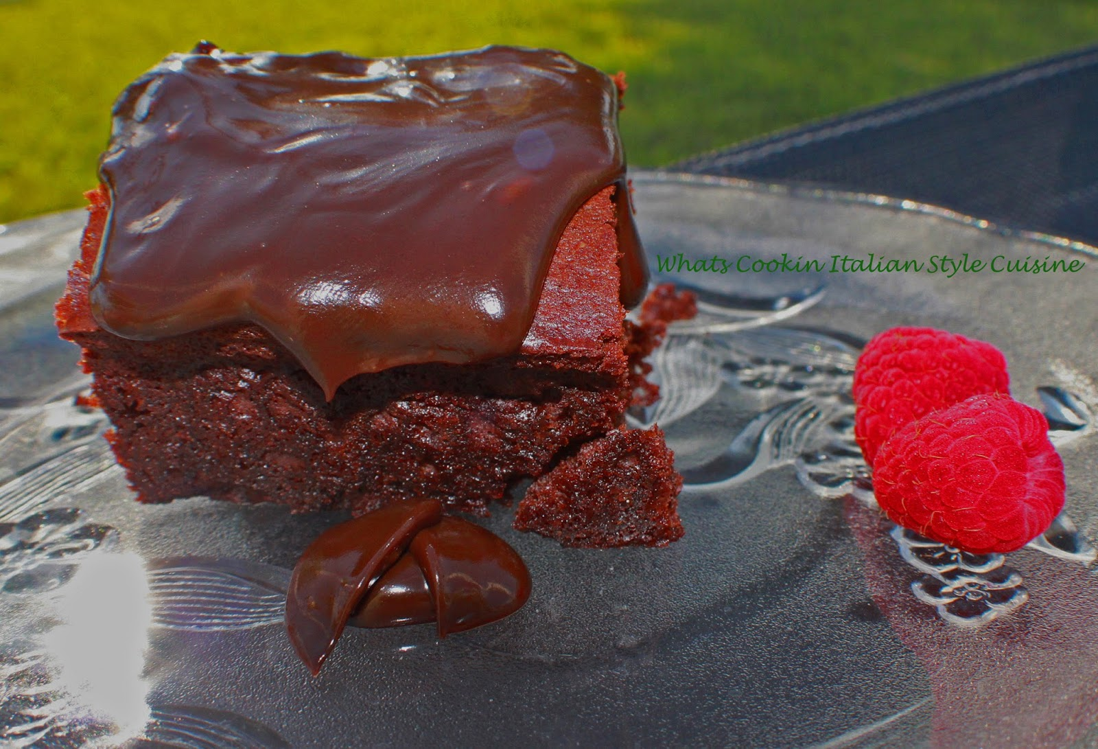 these are a decadent brownie on a clear glass plate dripping with Triple chocolate brownie are the the best for any  chocolate lovers