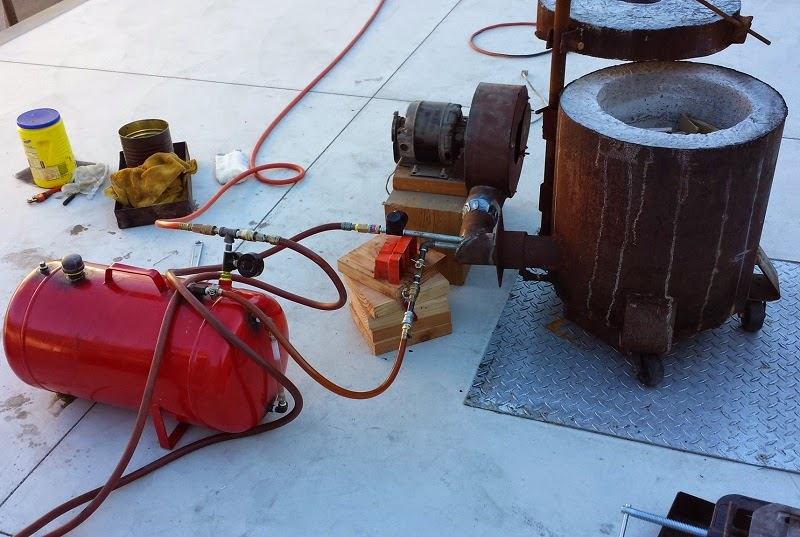 foundry set up with pressure tank, blower, and burner