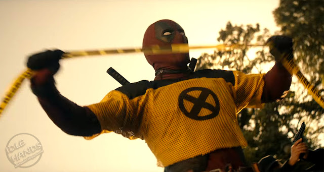 FOX Deadpool 2 Trailer Stills Deadpool in a crop X-Men Shirt
