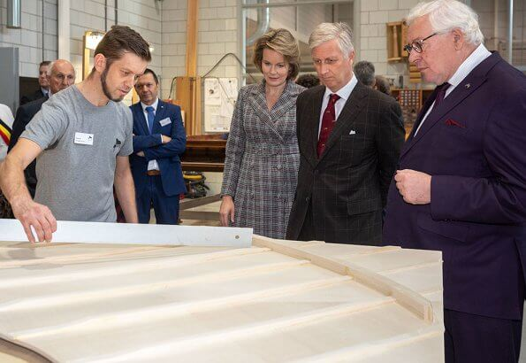 King Philippe and Queen Mathilde visited the Penitentiary Agricultural Center in Ruiselede and business Piano's Maene. Natan coatdress.