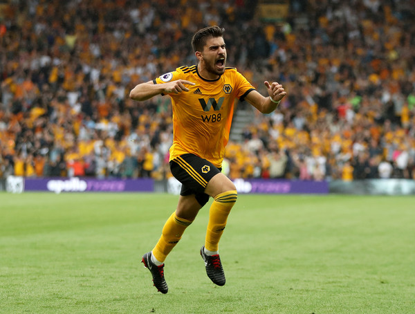 Ruben Neves of Wolverhampton Wanderers celebrates after scoring his team's first goal during the Premier League match between Wolverhampton Wanderers and Everton FC at Molineux on August 11, 2018 in Wolverhampton, United Kingdom.