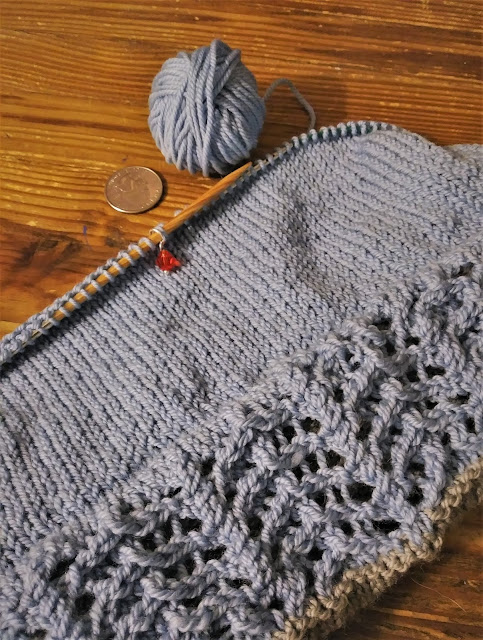 Two toned knit hat with double layered brim with lace trim.