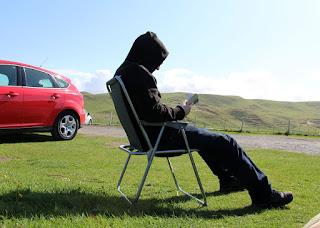 CJC reading at Machir Bay carpark