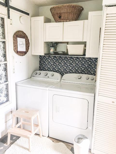 vintage laundry room decor with sliding door
