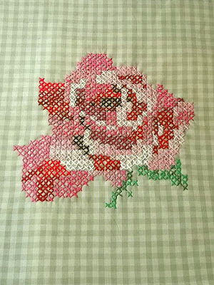Rose cross-stitched on 1/4 inch gigham