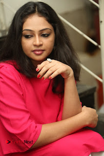 Actress Arundathi Nair Stills in Red Chididar at Bethaludu Success Meet  0085.JPG