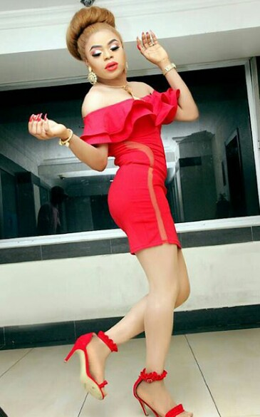 Bobrisky looks very hot in curve red hugging dress