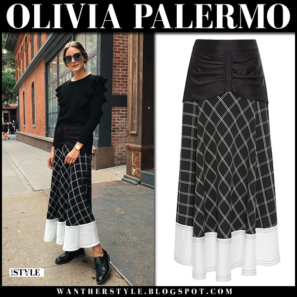 Olivia Palermo in black sweater and black check print skirt self portrait nyfw front row september 8