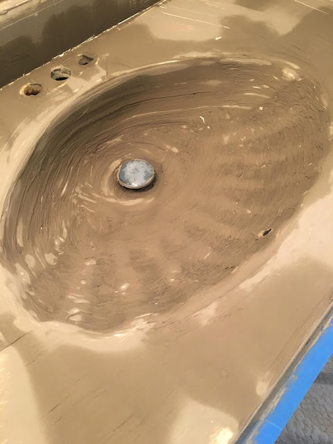 I updated our gold glittered, sea shell sink with feather finish concrete. So much better!!! I can't believe I had been nervous to try this. It's easy! #featherfinish #concretecountertops