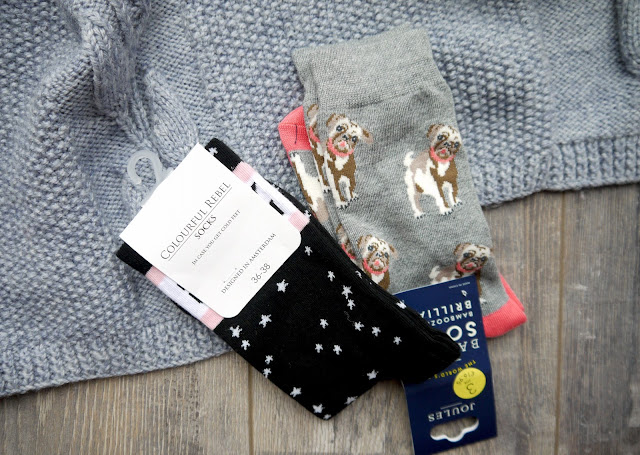 black socks with white stars, grey socks with brown french bulldogs