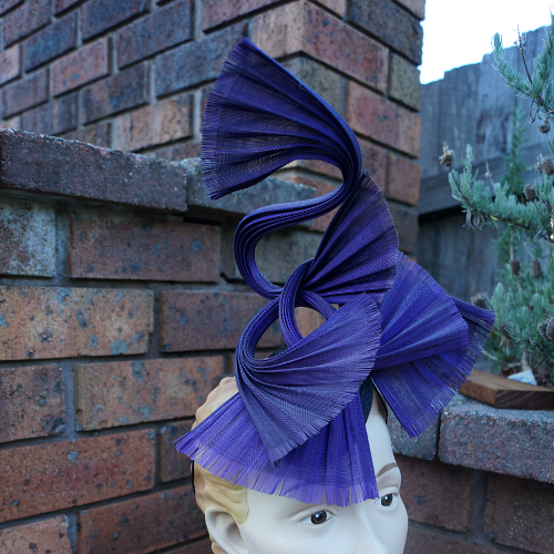 Purple Jinsin fascinator by Tanith Rowan Designs