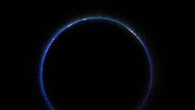 Pluto's blue atmosphere in the infrared