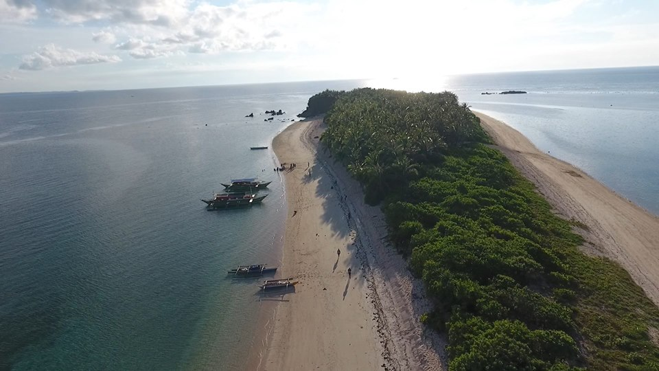 best islands in the philippines parola beach camarines norte